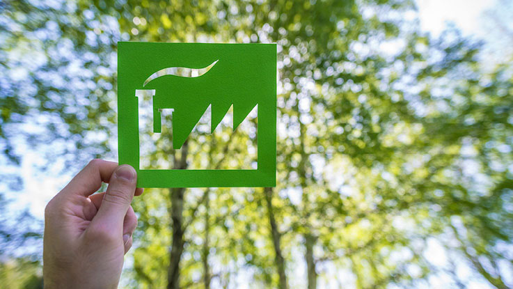 Green factory card with tree and sky in background