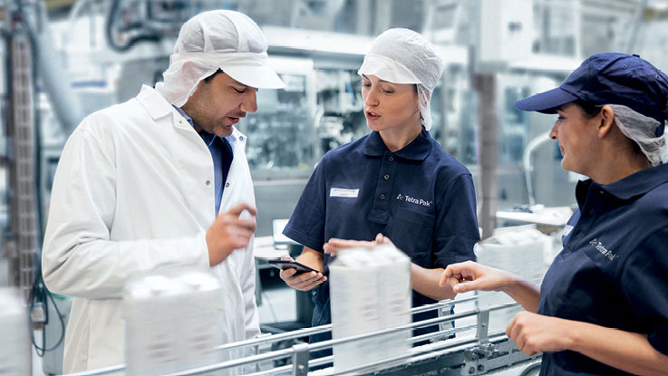 People in factory analysing data